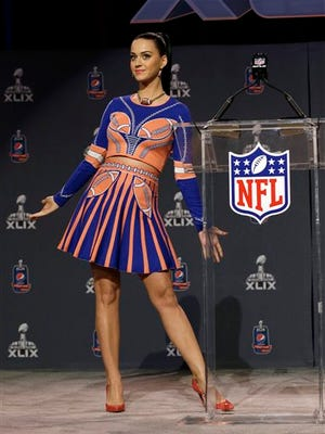 Katy Perry shows off her dress at a halftime news conference for NFL Super Bowl XLIX football game Thursday in Phoenix.