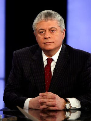"""FILE- In this April 11, 2011, file photo, Andrew Napolitano appears on the """"Varney & Co."""" program on the Fox Business Network, in New York. Fox News Channel legal analyst Napolitano returned to the air on Wednesday, March 29, 2017, saying he stood by his claim about spying on President Donald Trump that got him benched by the network for more than a week. Napolitano had said on Fox that British intelligence officials had helped former President Barack Obama spy on Trump."""