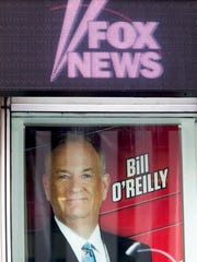 A poster featuring Bill O'Reilly is displayed at the News Corp. headquarters in Midtown Manhattan, Wednesday, April 19, 2017. Bill O'Reilly has lost his job at Fox News Channel following reports that five women had been paid millions of dollars to keep quiet about harassment allegations.
