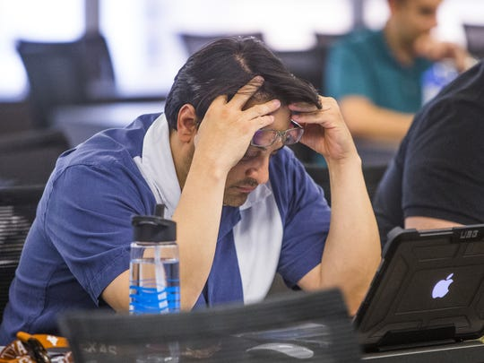 George Bustamante, 49, of El Paso, Texas, studies during a class on secured transactions at Arizona Summit Law School in Phoenix on April 12, 2018.