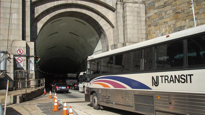 An NJ Transit bus heads into the Lincoln Tunnel in Weehawken. New Jersey works are finding jobs, but the work might be out of state.