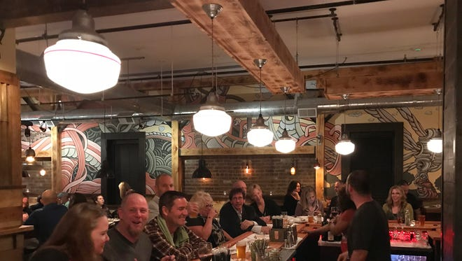 Patrons inside Melzingah Tap House during their soft opening for friends and family on April 27, 2018.