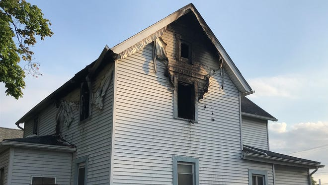 Fire confined to a second floor bedroom injured a juvenile male in another part of the upstairs.