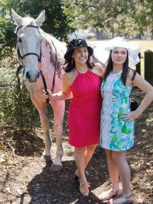 Jill wears a J. McLaughlin jacquard dress and hat from That's Hats in Chadds Ford, Pennsylvania. Mikki sports a Lilly Pulitzer dress from Wilmington Country Store in Greenville) and a hat from That's Hats.