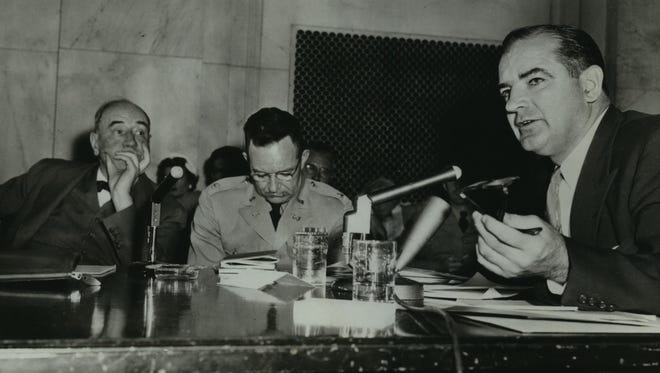 U.S. Sen. Joseph McCarthy (right) speaks as Army counsel Joseph N Welch listens, sort of, during the Army-McCarthy hearings investigating counter changes of Communist infiltration and requests for service privileges in 1954. Lt. Col. F.T. Murray is in the center.