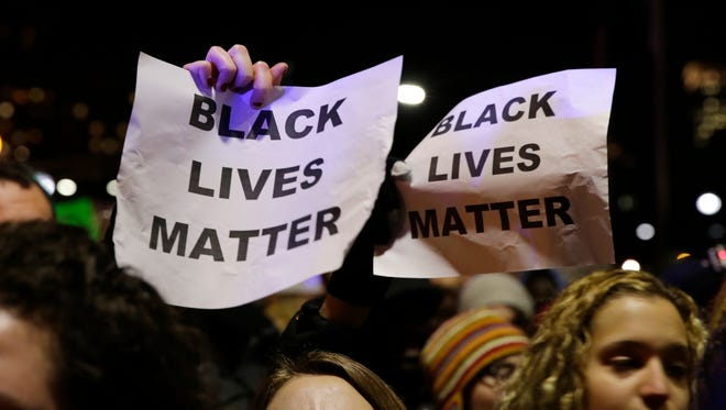 """People chant """"Black Lives Matter"""" during a demonstration in Boston on Dec. 4, 2014."""