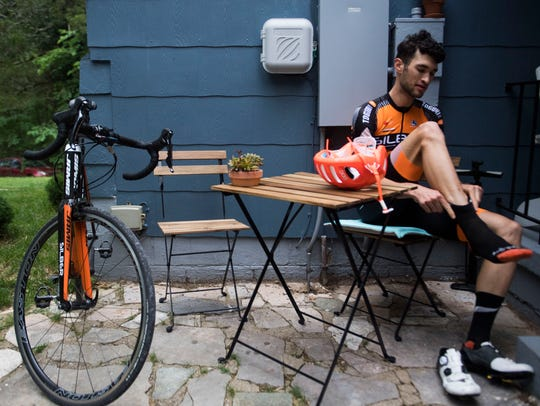 Knoxville cyclist Stephen Bassett puts on his gear