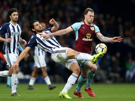 Burnley's Ashley Barnes, right, and West Bromwich Albion's Ahmed Hegazi during the English Premier League soccer match at The Hawthorns in West Bromwich, England, Saturday March 31, 2018. (David Davies/PA via AP)