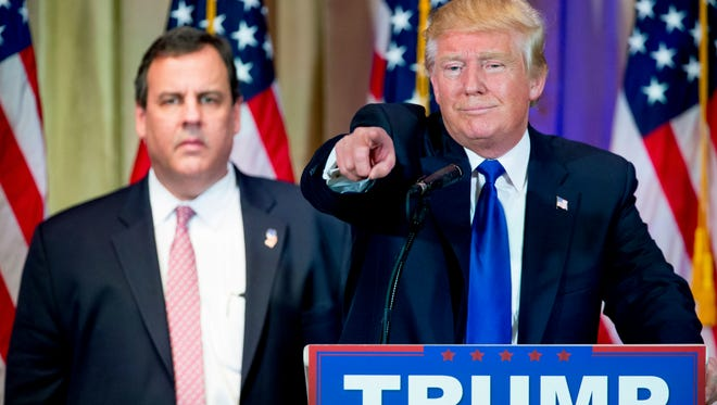 Republican presidential candidate Donald Trump, accompanied by New Jersey Gov. Chris Christie, left, takes questions from members of the media during a news conference on Super Tuesday primary election night in the White and Gold Ballroom at The Mar-A-Lago Club in Palm Beach, Fla., Tuesday, March 1.