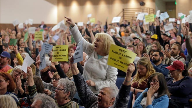 Tami Sablan shouts as Rep. Jason Chaffetz speaks during a town hall meeting at Brighton High School, Thursday, Feb. 9, 2017, in Cottonwood Heights, Utah. Hundreds of people lined up early for a town hall with Chaffetz on Thursday evening, many holding signs criticizing the congressman's push to repeal the newly-named Bears Ears National Monument in southern Utah. (AP Photo/Rick Bowmer)