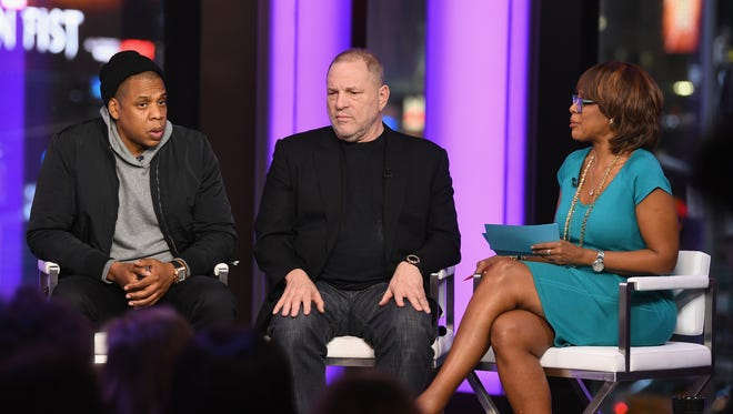 "Jay Z (from left), Harvey Weinstein, and Gayle King speak during ""Time and Punishment,"" a town hall discussion on March 8, 2017, in New York City."
