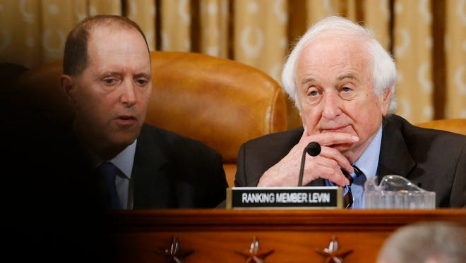Rep. Sander Levin, D-Mich., ranking Democrat on the House Ways and Means Committee, right, and Committee Chairman Rep. Dave Camp, R-Mich., listen on Capitol Hill in Washington, Friday, May 17, 2013, as ousted IRS Chief Steve Miller and J. Russell George, Treasury Inspector General for Tax Administration, testify before the committee's hearing on the Internal Revenue Service (IRS) practice of targeting applicants for tax-exempt status based on political leanings. (AP Photo/Charles Dharapak)