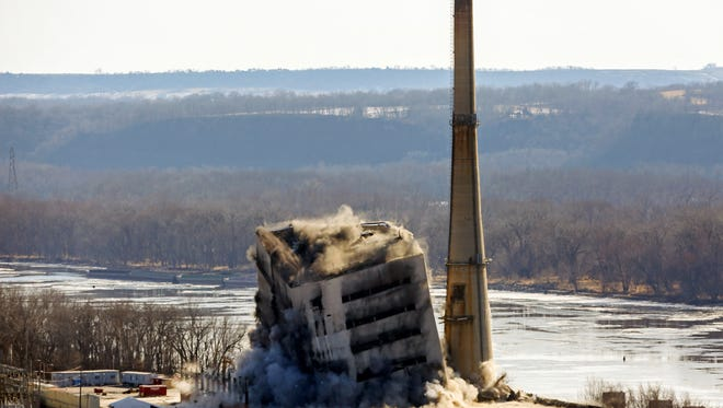 This Dec. 14, 2017 file photo shows the coal-fired Nelson Dewey Generating Station in Cassville, Wis., being imploded. The plant operated by Alliant Energy closed in 2015. The global fleet of coal-fired power plants is projected to begin shrinking by 2022 as plant retirements outpace new construction, according to a new report.