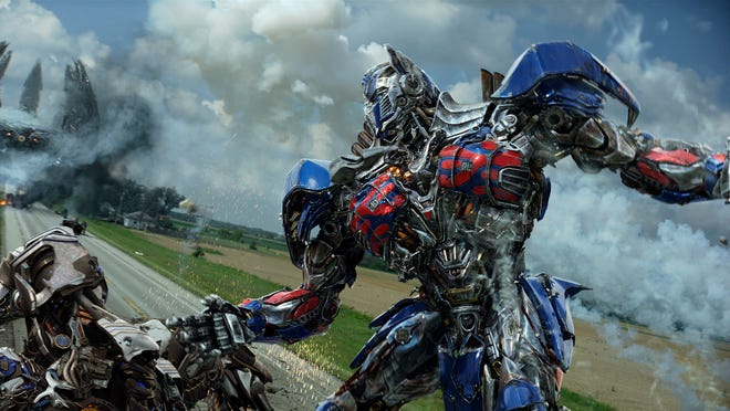 """Optimus Prime returns to battle for a fourth time in """"Transformers: Age of Extinction."""""""