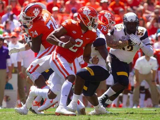 Clemson quarterback Kelly Bryant.carries the ball against