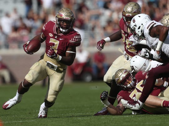 FSU's Cam Akers runs the ball against Louisiana Monroe