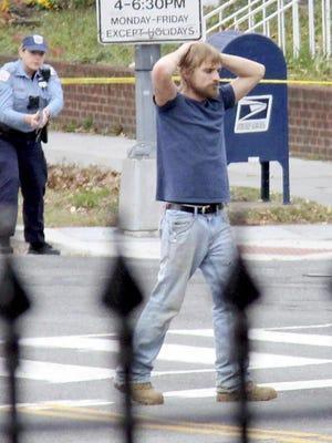 Edgar Maddison Welch, 28, of Salisbury, N.C., surrenders Sunday after allegedly firing an assault rifle inside a Washington pizza restaurant.