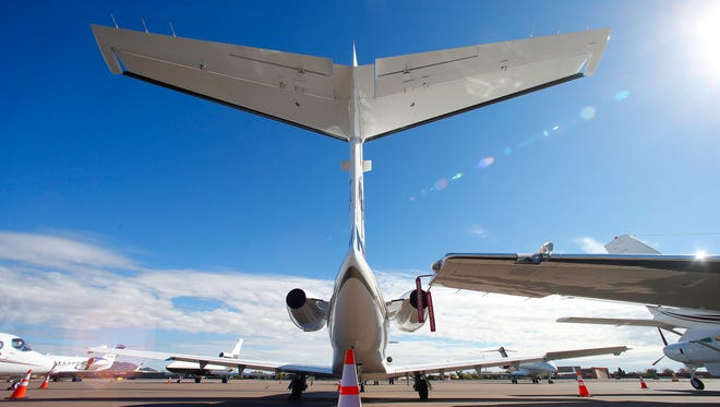 A growing number of private jets sit parked at Scottsdale Airport in Scottsdale, Arizona.