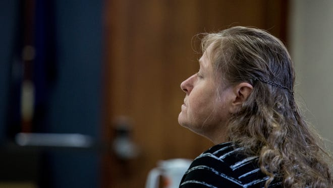 Judy Higley-Zueklke listens her trial Thursday, Jan, 5, 2017 at the St. Clair County Courthouse in Port Huron.