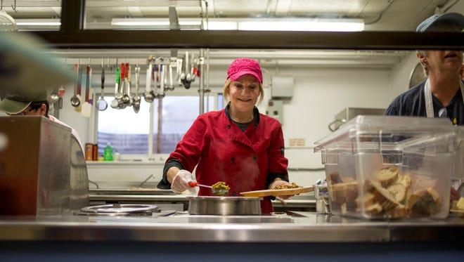 Volunteer Heidi Richards, of Fort Gratiot, serves food Wednesday, Jan. 25, 2017 at Mid City Nutrition, 805 Chestnut St. in Port Huron.