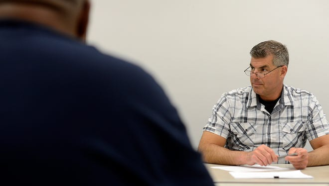 At right, Ron Connolly, a former police officer who teaches criminal justice, and other volunteers listen to ex-offenders during a weekly Goodwill Community Circles of Support meeting at Goodwill's Green Bay West store last week.