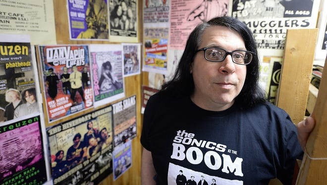 Tom Smith, the longtime face of Green Bay's The Exclusive Co., manages the city's oldest independent record store on Dousman Street.
