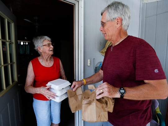 Meals on Wheels volunteer Joe Bob Fuller makes a delivery to May Newberg and visits with her on Tuesday, July 3, 2018.