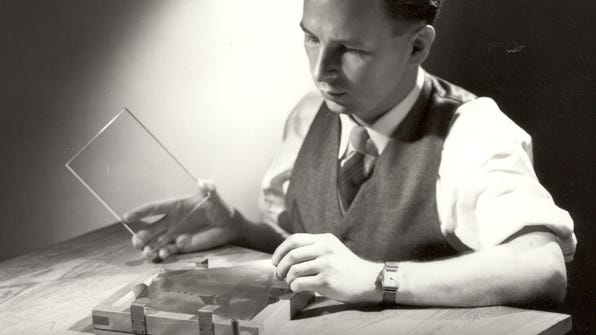 Dr. Don Stookey, shown here in 1950, prepares to expose an image to ultraviolet light.