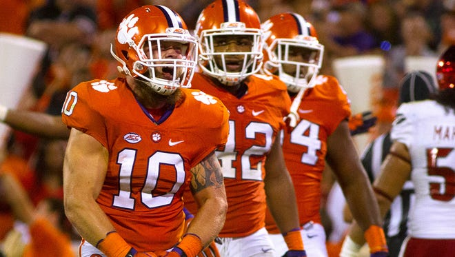 Clemson players celebrate reacts after getting a sack against Louisville.