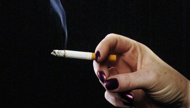 Smoking in bars will no longer be allowed on island beginning next year, but the law will be only effective if elected officials ensure the government can effectively enforce it.
