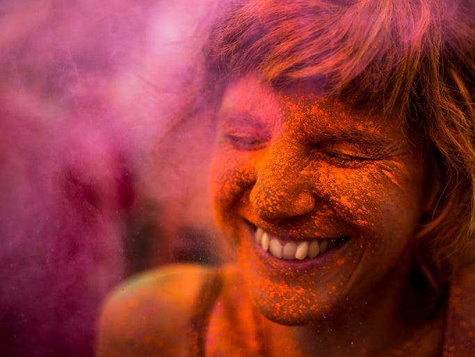 A reveler is covered in coloured powder,  during a Monsoon Holi Festival in Madrid, Spain, Saturday, Aug. 9, 2014. The festival is based on the Hindu spring festival Holi, also known as the festival of colours where participants colour each other with dry powder and coloured water.  (AP Photo/Andres Kudacki)