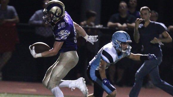 Clarkstown North's Joseph O'Hara runs for a touchdown