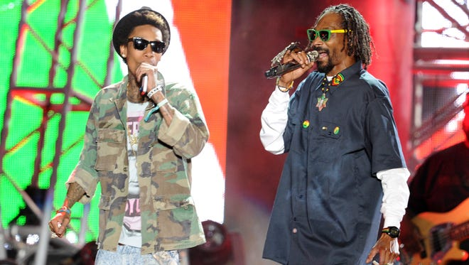 Wiz Khalifa (L) and Snoop Dogg perform onstage during day 3 of the 2012 Coachella Valley Music & Arts Festival at the Empire Polo Field on April 15, 2012 in Indio, California.