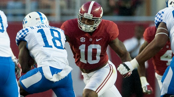 "Alabama linebacker Reuben Foster (10) closes on Kentucky running back Stanley ""Boom"" Williams (18) at Bryant-Denny Stadium in Tuscaloosa, Ala., on Saturday October 1, 2016."