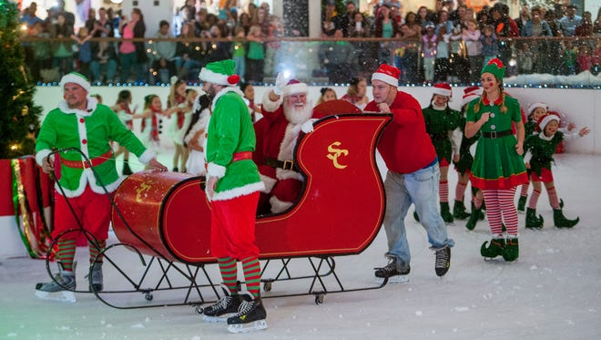 Santa Claus arrives in the snow on the ice at the Eastdale Mall Ice Palace as the Ice Palace skaters perform in Montgomery, Ala., on Friday November 11, 2016.