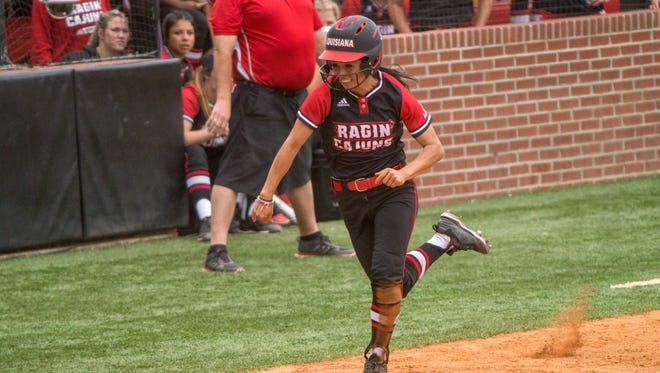 UL senior Kelli Martinez sprints home for a run during the Cajuns' doubleheader sweep of ULM on Saturday at Lamson Park.