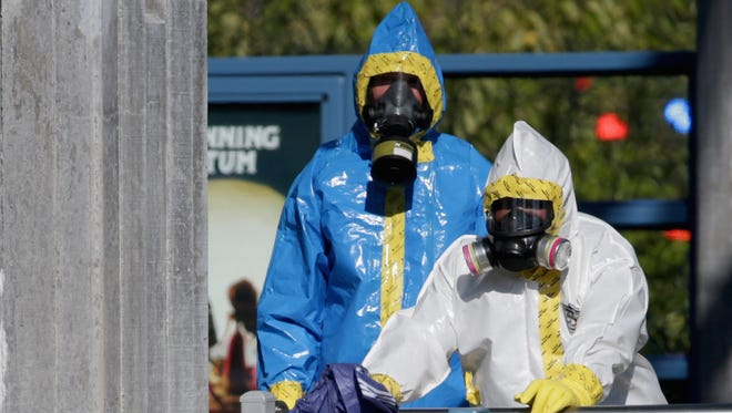 First responders wear full biohazard suits while responding to the report of a woman with Ebola-like symptoms in Dallas.