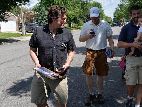 Aric Putnam goes door to door campaigning Saturday,
