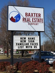 The business sign for Baxter Real Estate Company was