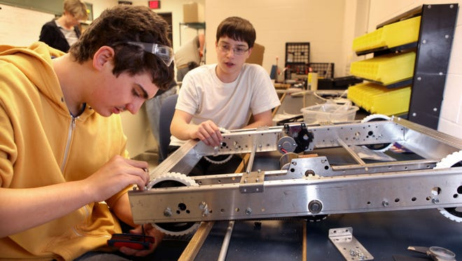 Ryle High School students David Holley, left, and Chandler Hoh work on their entry the FIRST Robotics Competition in the fledging NKY Makerspace in January, before the place was transformed for the community.