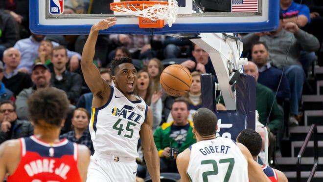 Utah Jazz guard Donovan Mitchell (45) dunks the ball during the first half against the Washington Wizards at Vivint Smart Home Arena.
