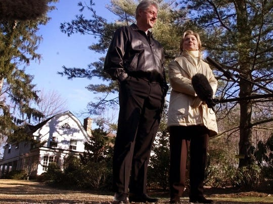"FILE - In this Jan. 6, 2000 file photo, Bill and Hillary Clinton stand in the driveway of their new home in Chappaqua, N.Y. A U.S. official says a ""functional explosive device"" was found at Hillary and Bill Clinton's suburban New York home. (AP Photo, File)"