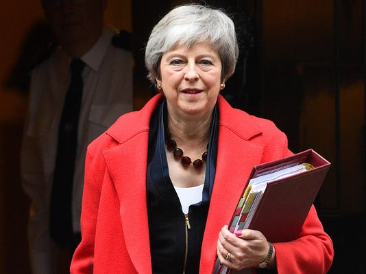 May to seek Brexit assurances after winning confidence vote