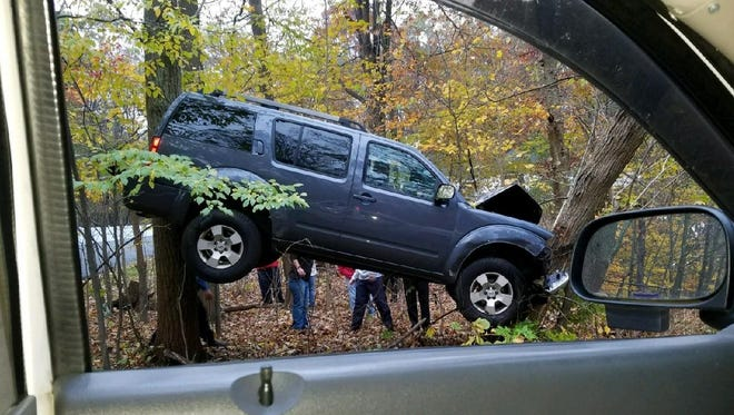 A vehicle veered off the road and was stuck between two trees, suspended off the group, last week.