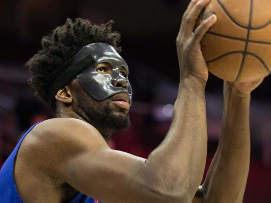 Philadelphia 76ers center Joel Embiid (21) practices with a protective mask before a game against the Milwaukee Bucks at Wells Fargo Center.