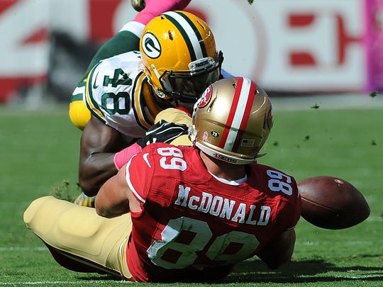 Packers linebacker Joe Thomas (48) knocks the ball loose from tight end Vance McDonald (89) against the San Francisco 49ers at Levi's Stadium.