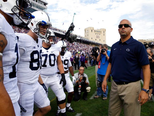 Penn State head coach James Franklin looks around before
