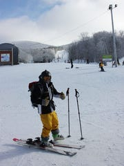 Warmly equipped to tackle the slopes, Eric Berliner of Richmond pauses at the base of a run Thursday at Bolton Valley. Photographed Dec. 28, 2017.