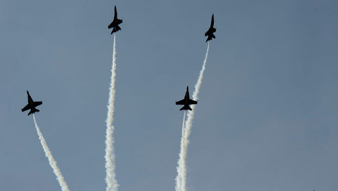 The Blue Angels perform during the 2014 Vero Beach Air Show at the Vero Beach Municipal Airport on Saturday. The Blue Angels are the U.S. Navy's flight demonstration squadron and fly the F/A-18 Hornet.