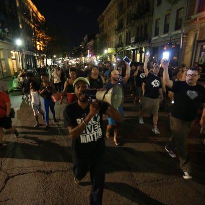 Demonstrators for Samuel DuBose march up Main Street.